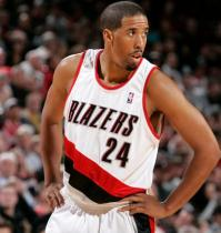 Andre Miller looks on in a Trail Blazers home jersey.JPG