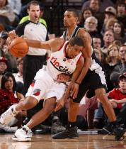 Andre Miller in Rip City uniform works against George Hill.JPG