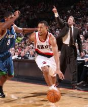Brandon Roy drives the baseline against Ryan Gomes.JPG