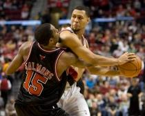 Brandon Roy keeps the ball away from John Salmons.JPG