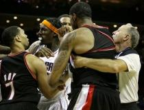 Brandon Roy tries to separate a scuffle.JPG