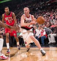 Steve Blake drives against the Nets.JPG