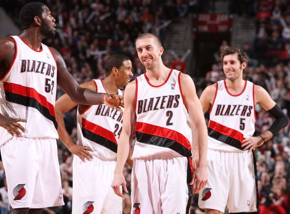 Steve Blake smiles with Greg Oden Andre Miller and Rudy Fernandez.JPG