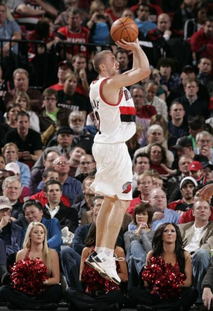 Steve Blake elevates for a jumper as the Blazers Dancers look on.JPG