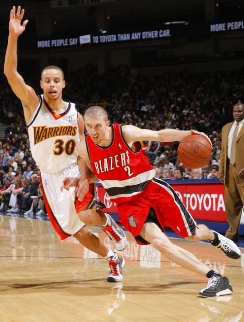 Steve Blake goes baseline against Stephen Curry.JPG
