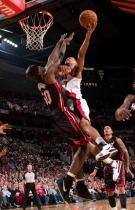 Brandon Roy takes it to the rack against Joel Anthony.JPG