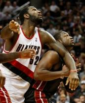 Greg Oden battles Dwayne Wade for inside position.JPG