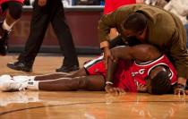 Greg Oden is fallen as he injured his knee again.JPG