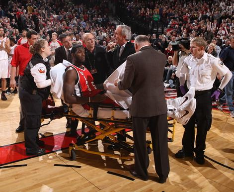 Greg Oden is on a stretcher after injuring his knee.JPG