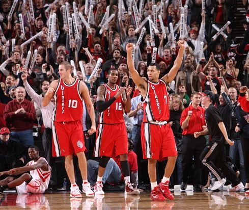 Joel Pryzbilla Lamarcus Aldrige and Brandon Roy celebrate.JPG