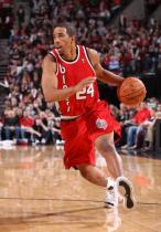 Andre Miller makes his move in red Blazers uniform.JPG