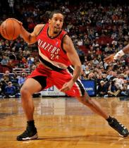 Andre Miller controls a high dribble.JPG