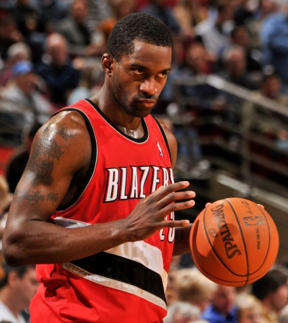 Martell Webster handles the ball in a red Trail Blazers road jersey.JPG
