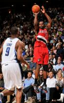 Martell Webster shoots as Rashard Lewis watches.JPG