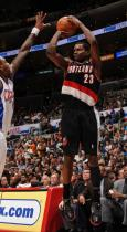Martell Webster shoots over Rasual Butler of the Clippers.JPG