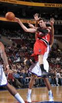 Rudy Fernandez jumps in the air and passes vs the 76ers.JPG