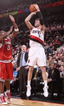 Rudy Fernandez elevates and shoots a jumper vs the Bucks.JPG