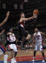 Rudy Fernandez in a black Trail Blazers jersey driving layup against the Pistons.JPG