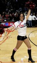 Brunette Blazer Dancer in black boots raises her pompoms.JPG