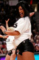 Blazer Dancer shows big smile as she dances in white Rip City shirt and black shorts.JPG