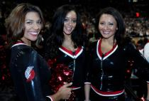 Three Blazer Dancers smile in black tops.JPG