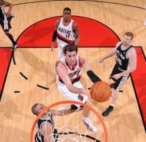 Rudy Fernandez scoops one up inside against the Spurs.JPG