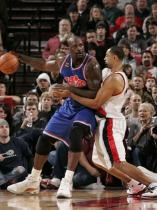 Juwan Howard guards Shaq Oneill.JPG