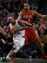 Juwan Howard and Rajon Rondo collide.JPG