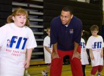 Brandon Roy and a girl at the NBA kids clinic.JPG