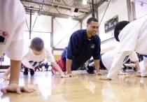 Brandon Roy does push ups with kids at an NBA basketball clinic.JPG
