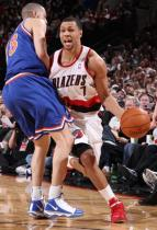 Brandon Roy drives past Anthony Parker.JPG