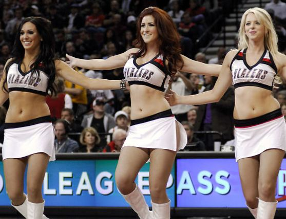 Three Blazer Dancers in white skirts performing.JPG