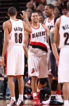 Brandon Roy smiles and gets a five from Batum as Camby looks on.JPG