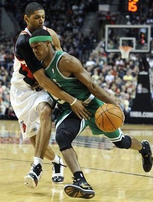 Nicholas Batum tries to slow down Rajon Rondo.JPG