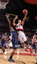 Brandon Roy shoots over CJ Miles.JPG