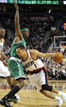 Brandon Roy drives against Rajon Rondo.JPG
