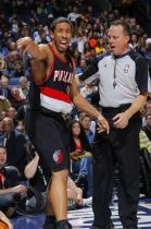Andre Miller in a black Trailblazers uniform complains to the referee.JPG