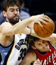 Rudy Fernandez fights for the ball with fellow Spanish player Marc Gasol.JPG