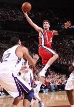 Rudy Fernandez in red Trail Blazers jersey layup attempt insde against the Kings.JPG