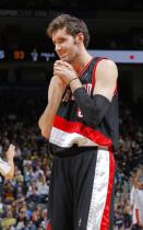 Rudy Fernandez in a black Blazers jersey puts hands together.JPG