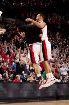 Brandon Roy gets a Jerryd Bayless jumping bump in celebration.JPG