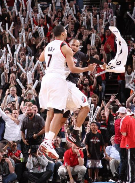Jerryd Bayless gives Brandon Roy a leaping chest bump.JPG