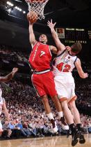Brandon Roy dunks on David Lee in a Rip City jersey.JPG