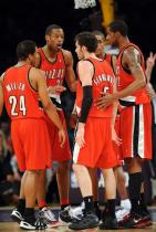 Blazers teammates Marcus Camby Andre Miller Rudy Fernandez LaMarcus Aldridge and Nicholas Batum talk things over.JPG