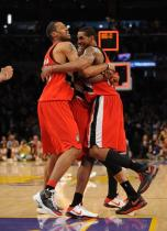 Marcus Camby and LaMarcus Aldridge and another teammate hug after a win vs the Lakers.JPG
