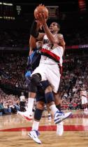 LaMarcus Aldridge is tackled by a Mavericks player as he goes in for the layup.JPG