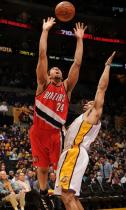 Andre Miller puts up a shot after being bumped by Derek Fisher.JPG