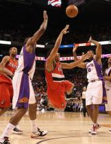 Andre Miller throws a shot up as he slips underneath the hoop.JPG