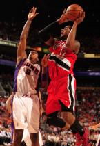 LaMarcus Aldridge goes up for a shot against Channing Frye in Phoenix.JPG