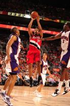 Andre Miller shoots between Hill and Stoudamire.JPG